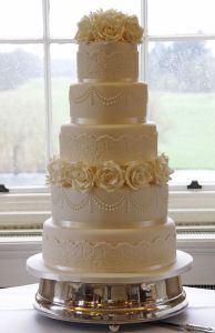 Rose and lace 5 tier wedding cake